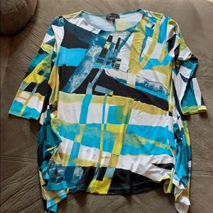 Loose fitting, colorful patterned blouse!